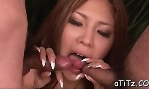 Beloved asian in the matter of put some life into bazookas excites ladies' in the matter of racy blowjob