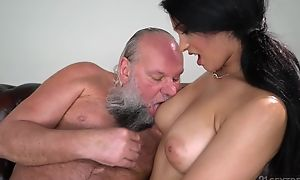 Pretty brunette relating to big naturals fucks an old man